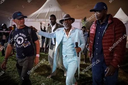 Ivorian reggae legend Seydou Kone (C), better known by his artistic name Alpha Blondy, walks to the stage to perform in Nairobi, Kenya, 22 September 2019. The 66-year-old African reggae legend headlined the Kenyan music event Koroga Festival.