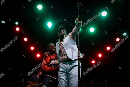 Ivorian reggae legend Seydou Kone (R), better known by his artistic name Alpha Blondy, performs on stage with a young boy he brought up from the crowd, in Nairobi, Kenya, 22 September 2019. The 66-year-old African reggae legend headlined the Kenyan music event Koroga Festival.
