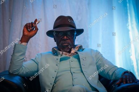 Stock Photo of Ivorian reggae legend Seydou Kone, better known by his artistic name Alpha Blondy, looks on as he rests backstage before his performance in Nairobi, Kenya, 22 September 2019. The 66-year-old African reggae legend headlined the Kenyan music event Koroga Festival.