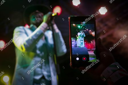 A fan films Ivorian reggae legend Seydou Kone, better known by his artistic name Alpha Blondy, as he performs on stage in Nairobi, Kenya, 22 September 2019. The 66-year-old African reggae legend headlined the Kenyan music event Koroga Festival.
