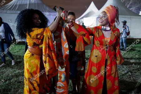 Backup singers of Ivorian reggae legend Seydou Kone, better known by his artistic name Alpha Blondy, raise their hands together as they prepare to go on stage in Nairobi, Kenya, 22 September 2019. The 66-year-old African reggae legend headlined the Kenyan music event Koroga Festival.