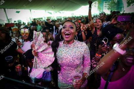 Fans cheer as a Kenyan artist warms up the crowd before Ivorian reggae artist Seydou Kone, better known by his artistic name Alpha Blondy, performs on stage in Nairobi, Kenya, 22 September 2019. The 66-year-old African reggae legend headlined the Kenyan music event Koroga Festival.