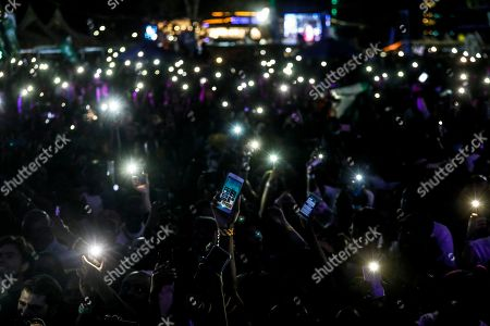 Fans raise their mobile phone lights as they wait for Ivorian reggae legend Seydou Kone, better known by his artistic name Alpha Blondy, in Nairobi, Kenya, 22 September 2019. The 66-year-old African reggae legend headlined the Kenyan music event Koroga Festival.
