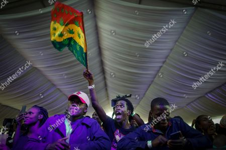 A fan cheers as a Kenyan artist warms up the crowd before Ivorian reggae artist Seydou Kone, better known by his artistic name Alpha Blondy, performs on stage in Nairobi, Kenya, 22 September 2019. The 66-year-old African reggae legend headlined the Kenyan music event Koroga Festival.
