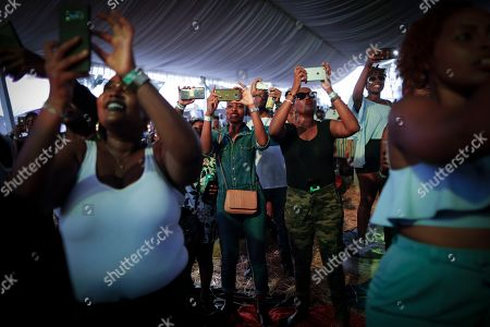 Fans film as a Kenyan artist warms up the crowd before Ivorian reggae artist Seydou Kone, better known by his artistic name Alpha Blondy, performs on stage in Nairobi, Kenya, 22 September 2019. The 66-year-old African reggae legend headlined the Kenyan music event Koroga Festival.