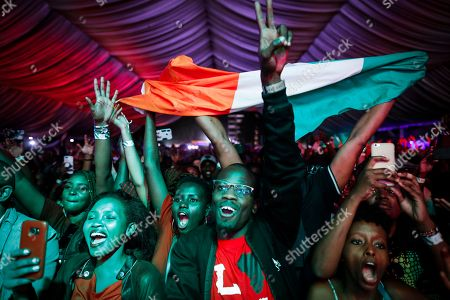 Fans cheer as Ivorian reggae legend Seydou Kone, better known by his artistic name Alpha Blondy, performs on stage in Nairobi, Kenya, 22 September 2019. The 66-year-old African reggae legend headlined the Kenyan music event Koroga Festival.