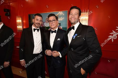 From left, Jimmy Kimmel, Stephen Colbert, and Ike Barinholtz attend the 71st Primetime Emmy Awards, at the Microsoft Theater in Los Angeles