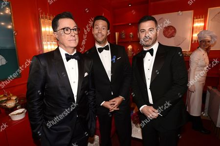 From left, Stephen Colbert, Ike Barinholtz, and Jimmy Kimmel attend the 71st Primetime Emmy Awards, at the Microsoft Theater in Los Angeles