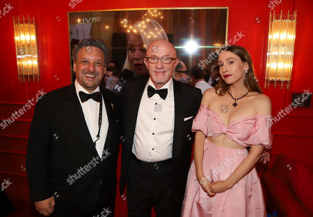 Stock Image of Frank Scherma, Jonathan Banks, Sarah Sutherland. Frank Scherma, Television Academy Chairman and CEO, from left, Jonathan Banks and Sarah Sutherland pose at the Lindt Chocolate Lounge at the 71st Primetime Emmy Awards, at the Microsoft Theater in Los Angeles
