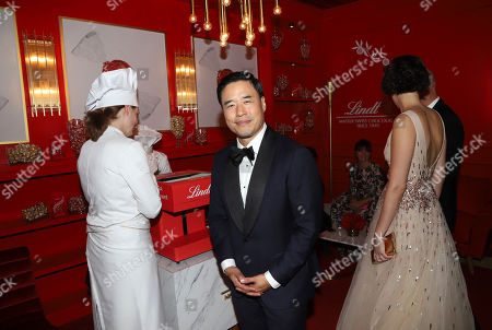 Randall Park, poses at the Lindt Chocolate Lounge at the 71st Primetime Emmy Awards, at the Microsoft Theater in Los Angeles