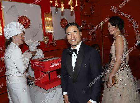 Randall Park, Phoebe Waller-Bridge. Randall Park, center, and Phoebe Waller-Bridge pose at the Lindt Chocolate Lounge at the 71st Primetime Emmy Awards, at the Microsoft Theater in Los Angeles