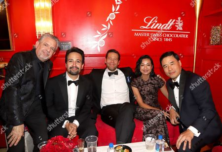 Luis A. Miranda, Jr., Lin-Manuel Miranda, Ike Barinholtz, Jae W. Suh, Randall Park. Luis A. Miranda, Jr., from left, Lin-Manuel Miranda, Ike Barinholtz, Jae W. Suh and Randall Park pose at the Lindt Chocolate Lounge at the 71st Primetime Emmy Awards, at the Microsoft Theater in Los Angeles