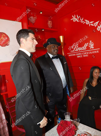Max Greenfield, Cedric the Entertainer. Max Greenfield, left, and Cedric the Entertainer at the Lindt Chocolate Lounge at the 71st Primetime Emmy Awards, at the Microsoft Theater in Los Angeles