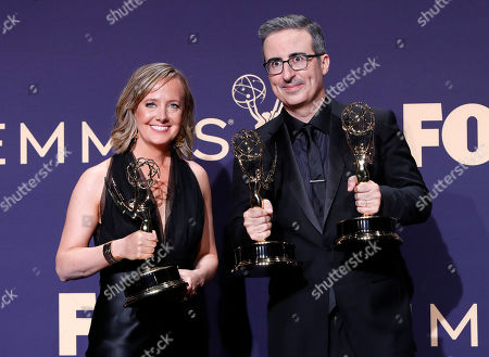 Liz Stanton (L) and John Oliver hold up their Emmy's for Outstanding Variety Talk Series for 'Last Week Tonight' and for Outstanding Writing at the 71st annual Primetime Emmy Awards ceremony held at the Microsoft Theater in Los Angeles, California, USA, 22 September 2019. The Primetime Emmys celebrate excellence in national primetime television broadcasting.