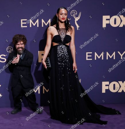 Peter Dinklage (L) jokes with Nathalie Emmanuel after winning the Emmy for Outstanding Supporting Actor in a Drama Series for 'Game of Thrones' at the 71st annual Primetime Emmy Awards ceremony held at the Microsoft Theater in Los Angeles, California, USA, 22 September 2019. The Primetime Emmys celebrate excellence in national primetime television broadcasting.