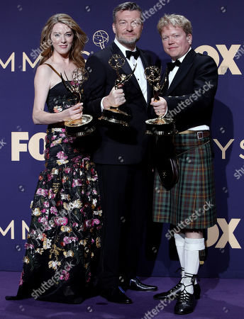 Annabel Jones (L), Charlie Brooker (C) and Russell McLean (R) holds the Emmy for Outstanding Television Movie for 'Bandersnatch' at the 71st annual Primetime Emmy Awards ceremony held at the Microsoft Theater in Los Angeles, California, USA, 22 September 2019. The Primetime Emmys celebrate excellence in national primetime television broadcasting.