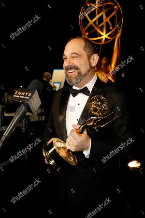 """Craig Mazin backstage with the award for outstanding writing for a limited series or movie for """"Chernobyl,"""" at the 71st Primetime Emmy Awards, at the Microsoft Theater in Los Angeles"""