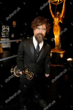 "Peter Dinklage backstage with the award for outstanding supporting actor in a drama series for ""Game of Thrones,"" at the 71st Primetime Emmy Awards, at the Microsoft Theater in Los Angeles"