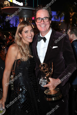 """Stock Picture of Guymon Casady, Robyn Norris. Guymon Casady, winner of the award for outstanding drama series for """"Game of Thrones,"""" right, and Robyn Norris attend the 71st Primetime Emmy Awards Governors Ball, at the Microsoft Theater in Los Angeles"""