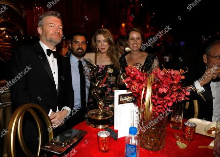 "Charlie Brooker, Annabel Jones. Charlie Brooker, left, and Annabel Jones, third from left, winners of the award for outstanding television movie for ""Black Mirror: Bandersnatch"" attend the 71st Primetime Emmy Awards Governors Ball, at the Microsoft Theater in Los Angeles"