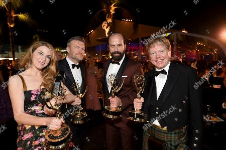 "Annabel Jones, Charlie Brooker, Russell McLean, Brett Gilman. Brett Gelman, winner of the award for outstanding comedy series for ""Fleabag,"" second from right, and from left, Annabel Jones, Charlie Brooker and Russell McLean, winners of the award for outstanding television movie for ""Black Mirror: Bandersnatch,"" attend the 71st Primetime Emmy Awards Governors Ball, at the Microsoft Theater in Los Angeles"