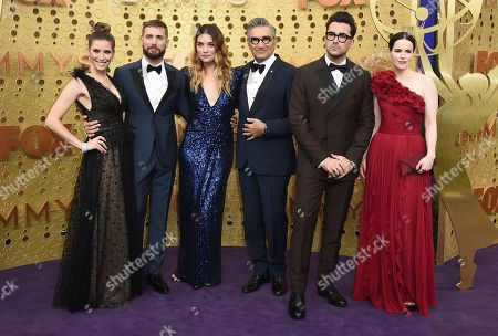 """Sarah Levy, Dustin Milligan, Catherine O'Hara, Annie Murphy, Eugene Levy, Daniel Levy, Emily Hampshire. Sarah Levy, from left, Dustin Milligan, Annie Murphy, Eugene Levy, Daniel Levy and Emily Hampshire, from the cast of """"Schitt's Creek,"""" arrive at the 71st Primetime Emmy Awards, at the Microsoft Theater in Los Angeles"""