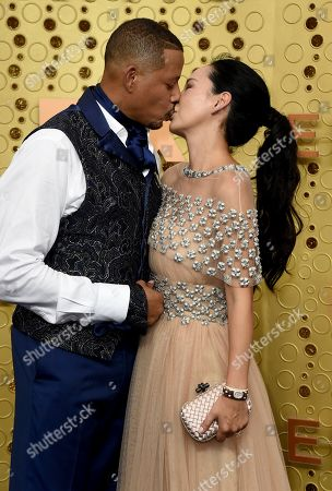 Terrence Howard, Mira Pak. Terrence Howard, left, and Mira Pak kiss as they arrive at the 71st Primetime Emmy Awards, at the Microsoft Theater in Los Angeles