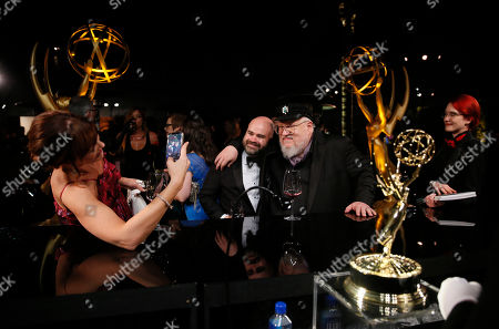 "Bryan Cogman, George R. R. Martin. Bryan Cogman, left, and George R. R. Martin, winners of the award for outstanding drama series for ""Game of Thrones,"" attend the Governors Ball winners circle at the 70th Primetime Emmy Awards, at the Microsoft Theater in Los Angeles"