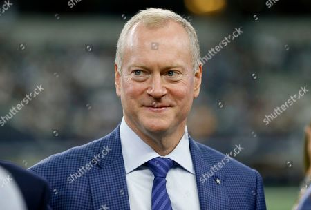 Jerry Jones Jr., Executive Vice President of the Dallas Cowboys, stands on the sideline prior to a NFL football game against the Miami Dolphins in Arlington, Texas