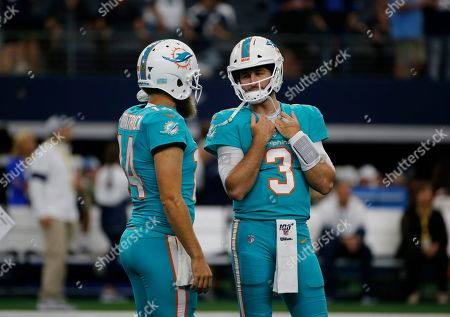 Stock Photo of Miami Dolphins quarterback Ryan Fitzpatrick (14) and quarterback Josh Rosen (3) talk prior to a NFL football game against the Dallas Cowboys in Arlington, Texas