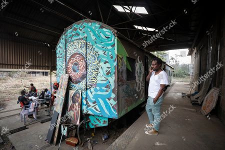 Artists work in front of an abandoned train carriage-turned art studio of an artist group Spray Uzi Crew, next to where artists from the Bombsquad, or BSQ Crew, work at the Nairobi Railway Museum in central Nairobi, Kenya, 20 August 2019 (issued 23 September 2019). Graffiti artists of BSQ Crew, originally started by three founding members, have been working out of an abandoned train carriage they rented from the Railway museum management which they turned into an art studio. Brian Musasia, also known by his artistic name Msale, is one of the original BSQ members. The twenty-six-year-old former art student says that at times, he struggles financially as a street artist in Kenya. Painting on a used pre-painted fabric he used in his house as a window curtain, Msale says the idea to paint over it came when he had no money to buy a canvas. 'It is our responsibility as (African) artists to tell a different story about Africa than what you have been told or been learning - the real stories we live'. Another founding member Bebeto Ochieng, or Thufu-B, says he believes in the role the art plays in society. 'We believe art is a weapon for change. And the new generation of Kenyan artists will shake the whole of Nairobi', the young artist says enthusiastically. Although many artists in Kenya struggle to earn enough for a living and it is rarely seen as a proper profession, yet the art scene in Nairobi has been growing in recent years with an increasing number of artists who gain recognition abroad.