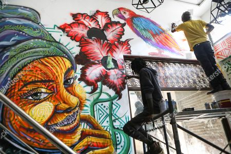 Kenneth Otieno, also known by his artistic name Kaymist4 (R), and Bebeto Ochieng, or Thufu-B (L), spray paint on the wall of their client, an ice cream parlor to be opened soon in Nairobi, Kenya, 07 September 2019 (issued 23 September 2019). Graffiti artists of BSQ Crew, originally started by three founding members, have been working out of an abandoned train carriage they rented from the Railway museum management which they turned into an art studio. Brian Musasia, also known by his artistic name Msale, is one of the original BSQ members. The twenty-six-year-old former art student says that at times, he struggles financially as a street artist in Kenya. Painting on a used pre-painted fabric he used in his house as a window curtain, Msale says the idea to paint over it came when he had no money to buy a canvas. 'It is our responsibility as (African) artists to tell a different story about Africa than what you have been told or been learning - the real stories we live'. Another founding member Bebeto Ochieng, or Thufu-B, says he believes in the role the art plays in society. 'We believe art is a weapon for change. And the new generation of Kenyan artists will shake the whole of Nairobi', the young artist says enthusiastically. Although many artists in Kenya struggle to earn enough for a living and it is rarely seen as a proper profession, yet the art scene in Nairobi has been growing in recent years with an increasing number of artists who gain recognition abroad.