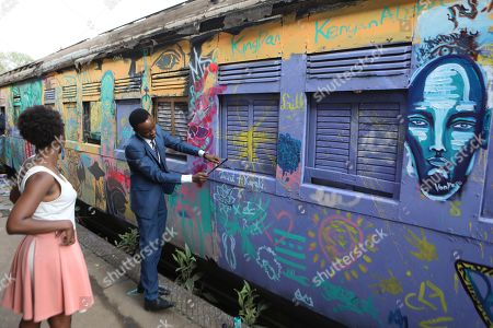 Visitors take part in painting an abandoned train carriage-turned art studio during an  exhibition by Kenyatta University art students who finished their internship programme with Bombsquad, or BSQ Crew at the Nairobi Railway Museum in central Nairobi, Kenya, 07 September 2019 (issued 23 September 2019). Graffiti artists of BSQ Crew, originally started by three founding members, have been working out of an abandoned train carriage they rented from the Railway museum management which they turned into an art studio. Brian Musasia, also known by his artistic name Msale, is one of the original BSQ members. The twenty-six-year-old former art student says that at times, he struggles financially as a street artist in Kenya. Painting on a used pre-painted fabric he used in his house as a window curtain, Msale says the idea to paint over it came when he had no money to buy a canvas. 'It is our responsibility as (African) artists to tell a different story about Africa than what you have been told or been learning - the real stories we live'. Another founding member Bebeto Ochieng, or Thufu-B, says he believes in the role the art plays in society. 'We believe art is a weapon for change. And the new generation of Kenyan artists will shake the whole of Nairobi', the young artist says enthusiastically. Although many artists in Kenya struggle to earn enough for a living and it is rarely seen as a proper profession, yet the art scene in Nairobi has been growing in recent years with an increasing number of artists who gain recognition abroad.