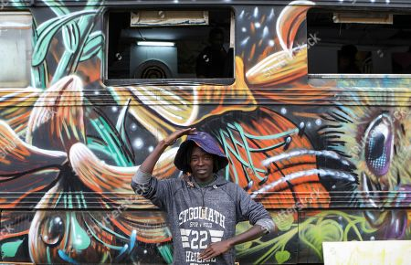 Bebeto Ochieng, also known by his artistic name Thufu-B, poses for a photograph in front of BSQ Crew's abandoned train carriage-turned art studio at the Nairobi Railway Museum in central Nairobi, Kenya, 07 September 2019. Graffiti artists of BSQ Crew, originally started by three founding members, have been working out of an abandoned train carriage they rented from the Railway museum management which they turned into an art studio. Brian Musasia, also known by his artistic name Msale, is one of the original BSQ members. The twenty-six-year-old former art student says that at times, he struggles financially as a street artist in Kenya. Painting on a used pre-painted fabric he used in his house as a window curtain, Msale says the idea to paint over it came when he had no money to buy a canvas. 'It is our responsibility as (African) artists to tell a different story about Africa than what you have been told or been learning - the real stories we live'. Another founding member Bebeto Ochieng, or Thufu-B, says he believes in the role the art plays in society. 'We believe art is a weapon for change. And the new generation of Kenyan artists will shake the whole of Nairobi', the young artist says enthusiastically. Although many artists in Kenya struggle to earn enough for a living and it is rarely seen as a proper profession, yet the art scene in Nairobi has been growing in recent years with an increasing number of artists who gain recognition abroad.