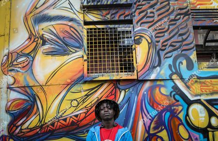 Brian Musasia, also known by his artistic  name Msale, poses for a photograph in front of BSQ Crew's abandoned train carriage-turned art studio at the Nairobi Railway Museum in central Nairobi, Kenya, 07 September 2019. Graffiti artists of BSQ Crew, originally started by three founding members, have been working out of an abandoned train carriage they rented from the Railway museum management which they turned into an art studio. Brian Musasia, also known by his artistic name Msale, is one of the original BSQ members. The twenty-six-year-old former art student says that at times, he struggles financially as a street artist in Kenya. Painting on a used pre-painted fabric he used in his house as a window curtain, Msale says the idea to paint over it came when he had no money to buy a canvas. 'It is our responsibility as (African) artists to tell a different story about Africa than what you have been told or been learning - the real stories we live'. Another founding member Bebeto Ochieng, or Thufu-B, says he believes in the role the art plays in society. 'We believe art is a weapon for change. And the new generation of Kenyan artists will shake the whole of Nairobi', the young artist says enthusiastically. Although many artists in Kenya struggle to earn enough for a living and it is rarely seen as a proper profession, yet the art scene in Nairobi has been growing in recent years with an increasing number of artists who gain recognition abroad.