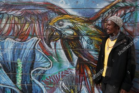 Kenneth Otieno, also known by his artistic name Kaymist4, poses for a photograph in front of BSQ Crew's mural at the Nairobi Railway Museum in central Nairobi, Kenya, 07 September 2019. Graffiti artists of BSQ Crew, originally started by three founding members, have been working out of an abandoned train carriage they rented from the Railway museum management which they turned into an art studio. Brian Musasia, also known by his artistic name Msale, is one of the original BSQ members. The twenty-six-year-old former art student says that at times, he struggles financially as a street artist in Kenya. Painting on a used pre-painted fabric he used in his house as a window curtain, Msale says the idea to paint over it came when he had no money to buy a canvas. 'It is our responsibility as (African) artists to tell a different story about Africa than what you have been told or been learning - the real stories we live'. Another founding member Bebeto Ochieng, or Thufu-B, says he believes in the role the art plays in society. 'We believe art is a weapon for change. And the new generation of Kenyan artists will shake the whole of Nairobi', the young artist says enthusiastically. Although many artists in Kenya struggle to earn enough for a living and it is rarely seen as a proper profession, yet the art scene in Nairobi has been growing in recent years with an increasing number of artists who gain recognition abroad.