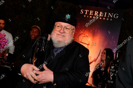 George R.R. Martin holds a bottle of Sterling wine at the 71st Primetime Emmy Awards Governors Ball, at the Microsoft Theater in Los Angeles