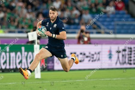 Scotland's wing Tommy Seymour runs with the ball