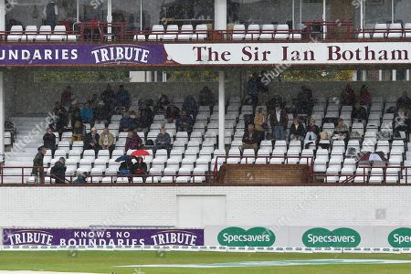 Rain Stops Play - Spectators shelter in the Sir Ian Botham Stand as the heavy rain continues to fall during the Specsavers County Champ Div 1 match between Somerset County Cricket Club and Essex County Cricket Club at the Cooper Associates County Ground, Taunton