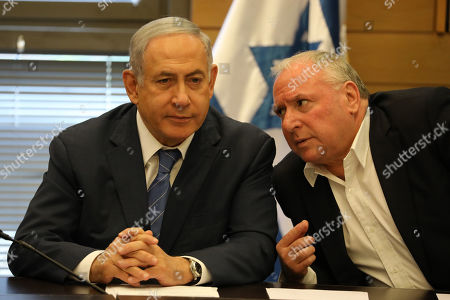 Acting Israeli Prime Minister and leader of the Likud party Benjamin Netanyahu (L) listens to an unidentified person as he attends his party faction meeting at the Knesset in Jerusalem, Israel, 23 September 2019. The Israel political scene remains marred by uncertainty after the 17 September election in which the Blue and White alliance led by Benny Gantz won 33 seats, outdoing the right-wing party of Likud presided by the current acting premier Benjamin Netanyahu, who had to settle for 31 seats. Avigdor Lieberman party will have a key role in forming the government coalition, as its eight seats could shift the balance towards Gantz or Netanyahu.