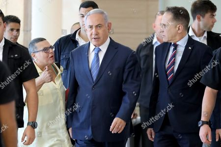 Stock Image of Acting Israeli Prime Minister and leader of the Likud party Benjamin Netanyahu (C) arrives to attend his party faction meeting at the Knesset in Jerusalem, Israel, 23 September 2019. The Israel political scene remains marred by uncertainty after the 17 September election in which the Blue and White alliance led by Benny Gantz won 33 seats, outdoing the right-wing party of Likud presided by the current acting premier Benjamin Netanyahu, who had to settle for 31 seats. Avigdor Lieberman party will have a key role in forming the government coalition, as its eight seats could shift the balance towards Gantz or Netanyahu.