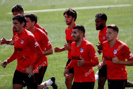 Atletico Madrid's Thomas Lemar (2-R), Angel Correa (3-R), Joao Felix (4-R) and Stefan (L), among others, attend a team's training session at club's sport complex in Alcala de Henares, outside Madrid, Spain, 23 September 2019. The team prepares its upcoming LaLiga game against RCD Mallorca at Majorca's Estadi de -son Moix stadium, on 25 September.