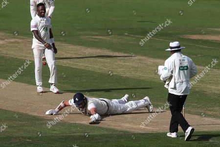 Kent batsman, Mitchell Claydon makes a dramatic attempt to get back into his crease to the amusement of Hampshire bowler, Fidel Edwards during Kent CCC vs Hampshire CCC, Specsavers County Championship Division 1 Cricket at the St Lawrence Ground on 23rd September 2019