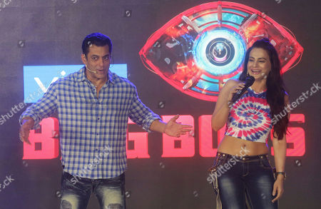"""Stock Image of Salman Khan, Ameesha Patel. Bollywood actor Salman Khan, left, speaks as actress Ameesha Patel reacts during an event to launch television show 'Bigg Boss 13', in Mumbai, India, . """"Bigg Boss"""" is an Indian version of reality television show """"Big Brother."""" It features housemates who live together for weeks isolated from outsiders while vying to avoid eviction and win a cash prize"""