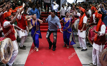 Bollywood actor Salman Khan dances as he arrives for the promotional event of television series Bigg Boss, in Mumbai, India, 23 September 2019. Salman Khan will host the reality show Bigg Boss in the thirteen season. The show is an Indian version of the British big Brother.