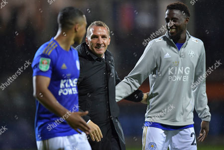 Brendan Rodgers manager of Leicester City congratulates Wilfred Ndidi of Leicester City and Youri Tielemans of Leicester City