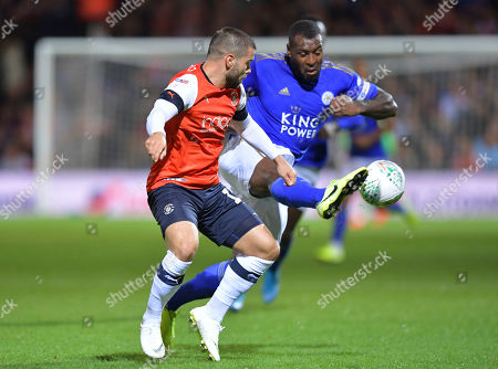 Elliot Lee of Luton Town and Wes Morgan of Leicester City