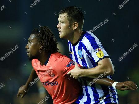 Jordan Thorniley of Sheffield Wednesday and Alex Iwobi of Everton