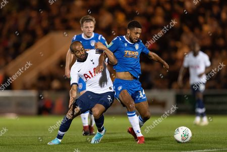 Lucas Moura of Tottenham Hotspur tries to run past Tom Lapslie of Colchester United  and Brandon Comley of Colchester United