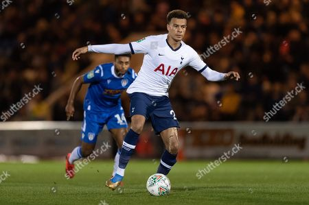 Dele Alli of Tottenham Hotspur and Brandon Comley of Colchester United